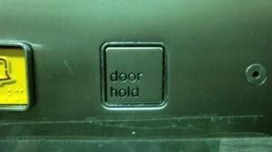 640px-Schindler_lifts_(Dewhurst_door_hold_button)